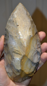 A very large, heavy and superbly worked Mousterian (Neanderthal) flint hand axe from the Dordoigne, Central France. SOLD